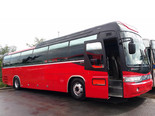 Красивый красный туристический автобус Оренбург - Уфа